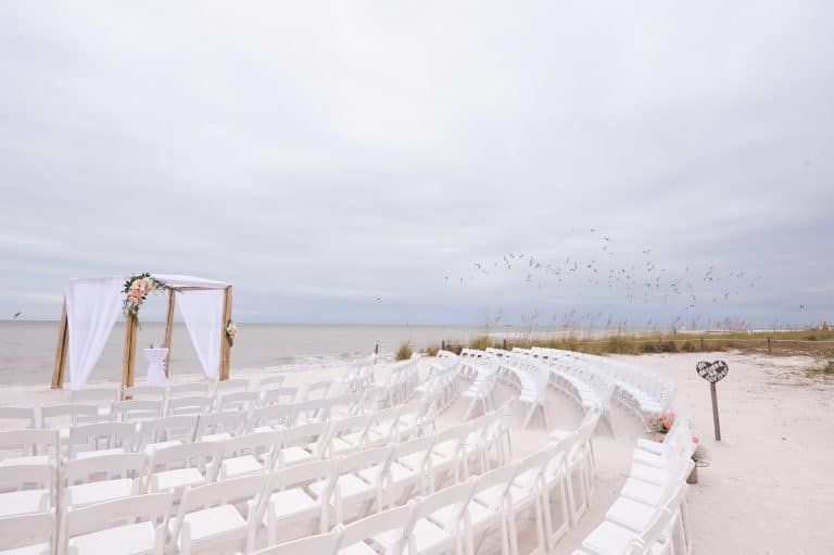 White Chairs with Wood Flower Curtain Alter at Lovers Key